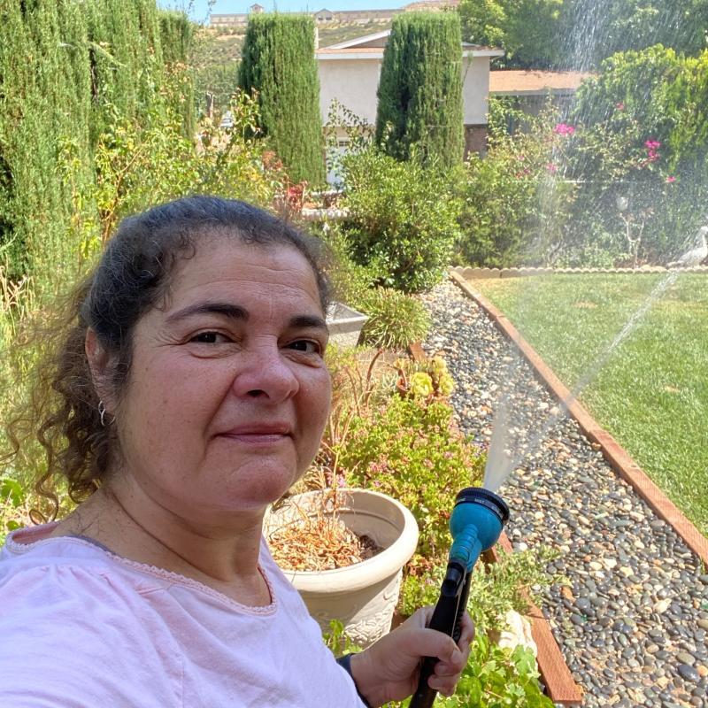Teri watering plants